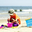 Boy playing toys on beach — Stock Photo