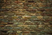 Background of old brick or stone wall texture — Stock Photo