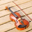Violin on sandy beach. Music concept — Stock Photo