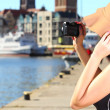 Stylish traveler woman with camera old town Gdansk — Stock Photo