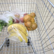 Stock Photo: Shopping cart with grocery at supermarket
