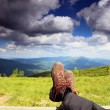 Stock Photo: Hiking shoes. Hiker enjoying view relaxing