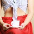 Female hand holding cup of hot beverage — Stock Photo