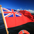 British maritime red ensign flag blue sky — Stock Photo #31661839