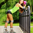 Woman roller skating sport activity in park — Stock Photo