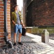 Young man with bag on street, old town Gdansk — Stock Photo