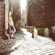 Young man with bag on street, old town Gdansk — Foto de Stock