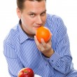 Young man with fruits healthy diet isolated — Stock Photo