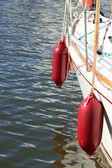 Yachting. parts of yacht maritime red fenders — Stock Photo
