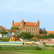 Gniew town with teutonic castle at Wierzycriver, Poland — Stock Photo #32159149