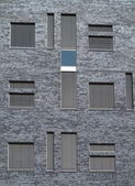 Windows with shutters in city gray wall pattern — Stock Photo