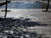 Stone road pavement and fountain cityspace — Stock Photo