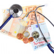 Stock Photo: Cost of health care: stethoscope on euro money