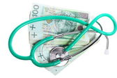 Cost of health care: stethoscope on polish money — Stock Photo