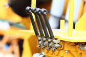 Detail of levers on new tractor industrial detail — Stock Photo