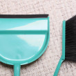 Stock Photo: Green sweeping brush and dustpon floor - housework