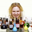 Crazy chemist woman with chemical glassware flask isolated — Stock Photo