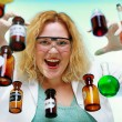 Crazy chemist woman with chemical glassware flask — Stock Photo