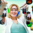 Stock Photo: Chemist woman with chemical glassware tubes
