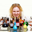 Crazy chemist woman with chemical glassware flask isolated — Stock Photo #33245779