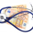 Cost of health care: stethoscope on euro money — Stock Photo