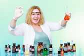 Chemist woman with glassware ok sign up gesture isolated — Stock Photo