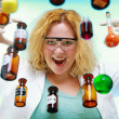 Stock Photo: Crazy chemist woman with chemical glassware flask