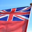 British maritime red ensign flag blue sky — Stock Photo #33379325