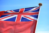 British maritime red ensign flag blue sky — Stockfoto
