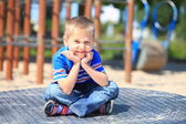 Thoughtful child boy or kid on playground — Stock Photo