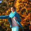 Woman having fun blowing bubbles in autumnal park — ストック写真
