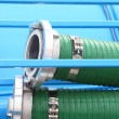 Stock Photo: Green plastic hose tube outdoor