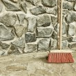Large broom on wall outdoor - housework — Stock Photo #33541473