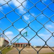 Metal mesh with blur basketball court background — Stock Photo
