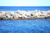 Stone breakwater for protection of coast — Stock Photo