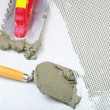 Construction notched trowel with mortar for tiles work — Stock Photo