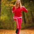 Healthy lifestyle. Fitness girl doing exercise outdoor — Stock Photo #33733807