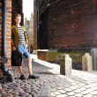 Young man with bag on street, old town Gdansk — Foto Stock