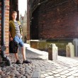Young man with bag on street, old town Gdansk — Lizenzfreies Foto