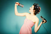 Sexy girl in curlers with hairdryer styling hair — Stock Photo