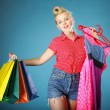Girl with shopping bags retro style — Stockfoto