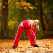 Healthy lifestyle. Fitness girl doing exercise outdoor — Stock Photo #34513625