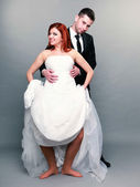 Happy married couple bride groom on gray background — Foto Stock
