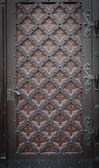 Decorative old wooden church door — Stock Photo