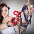 Summer girl plenty of jewellery beads in hands — Stock Photo