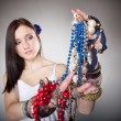 Summer girl plenty of jewellery beads in hands — Stock Photo #35086741