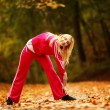 Healthy lifestyle. Fitness girl doing exercise outdoor — Stock Photo #35155531