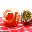 Jars with spices paprika and lovage isolated — Stock Photo