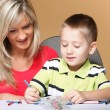 Mother and son drawing together — Photo