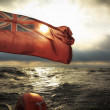 British maritime ensign flag boat and stormy sky — Stock Photo #35222287